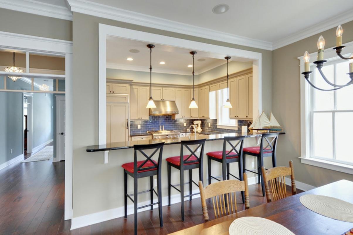 Дизайн кухни с барной стойкой и столовой